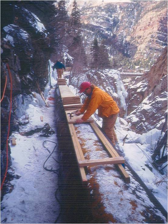 Winter of 1995/1996. construction of the original wooden walkway in the School Room and Trestle areas.