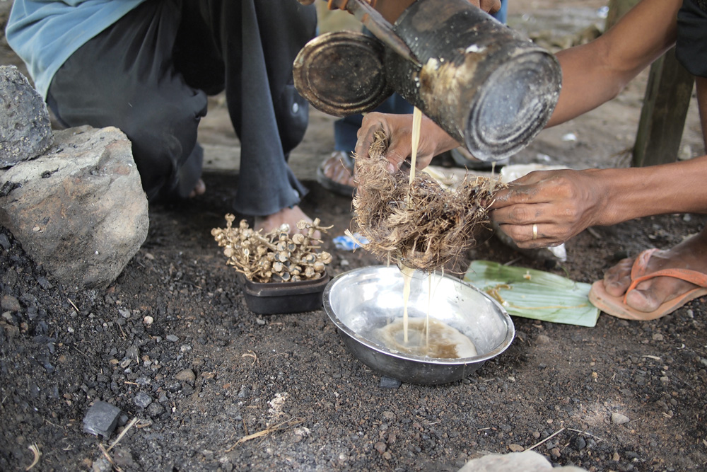 The melted wax is poured through abaca fibers to filter it of debris