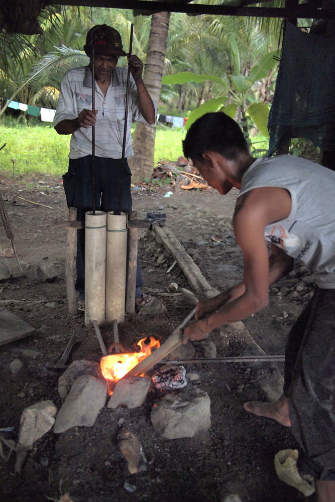This underground furnace is fed by a bellows made of PVC pipe where bamboo was traditionally used