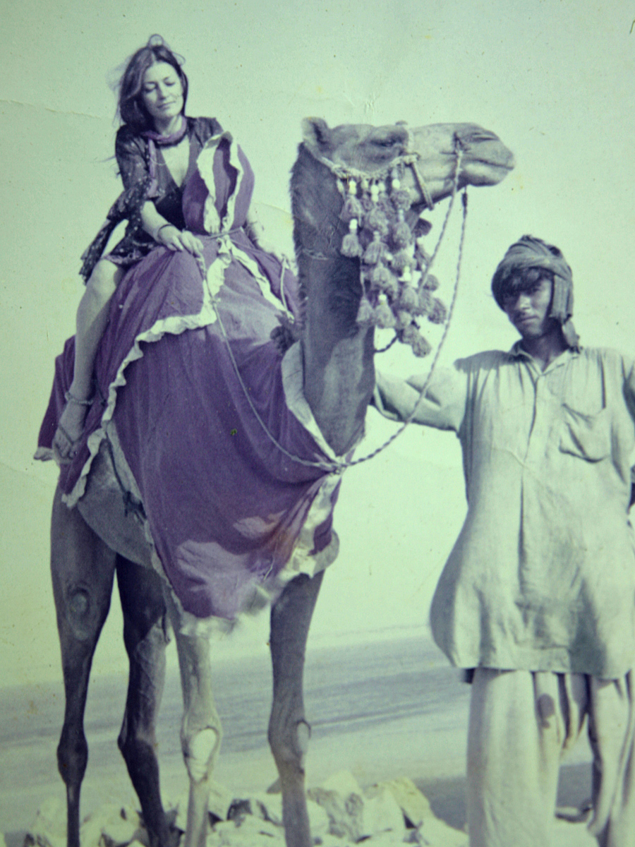 Stephanie hitches a ride on a camel in the Balochistan Desert in south western Pakistan. She was a lone Asian traveler during the wild days of what was known as the 'hippie era', and bumped into Bruce on route to Nepal.