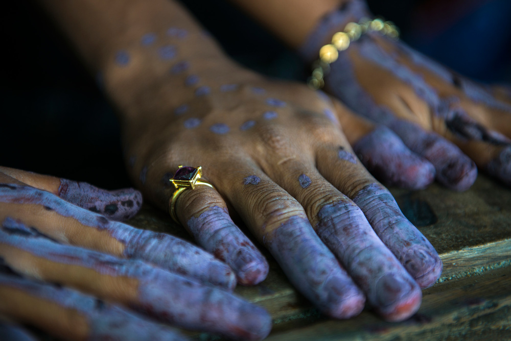 Hands of a Sama-Bajau bride and groom with henna tattoos. The tattoos are placed on their hands to signify their bond together on their wedding day. The design itself is created by the couple but the tattoos should be placed on both of their hands.