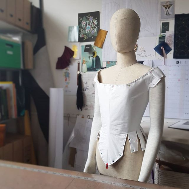 Quite the challenging project today. I'm making 1660s style dresses out of a material called tyvek for an exhibition. It's not really a fabric, it creases like crazy, can't be ironed, and can't be pinned without leaving a permanent hole... think sewing a plastic bag... on a mannequin with no squish. 🤔  This is taking a lot of experimenting, so I'm currently on the 4th iteration of this bodice. This one is spray mounted onto felt and pinned over a boned calico base.  Don't worry if stuff doesn't go right first time, it's not failure, it's just one of the steps towards getting it right. . . . . . . #sewing #tyvek #museum #mannequin #1660s #gown #bodice #costumemaking #dressmaking #madeinbritain #historicalcostume #17thcentury #challenge