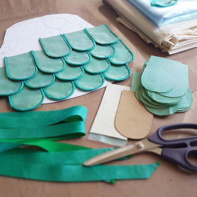Something a little different on the table today. I'm adding tummy scales to a big blue furry monster.  The binding is made of blue poly organza and green cotton. I attached them together with temporary fabric spray adhesive. It's really quick to do and stays flexible so it's easy to see the binding on. . . . . . #theatre #childrenstheatre #sewing #costumemaker #scales #monster #505spray #organza #shoplocal #madeinbritain