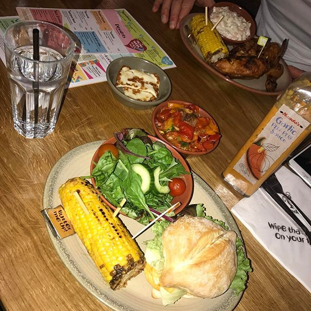 Me and @just_cathal_92 are finally finished prep so having a cheeky Nandos but poor @kadiesmithxx is drinking water because she's stepping on the European stage on Sunday 😬 #ourchamp 👙🏆