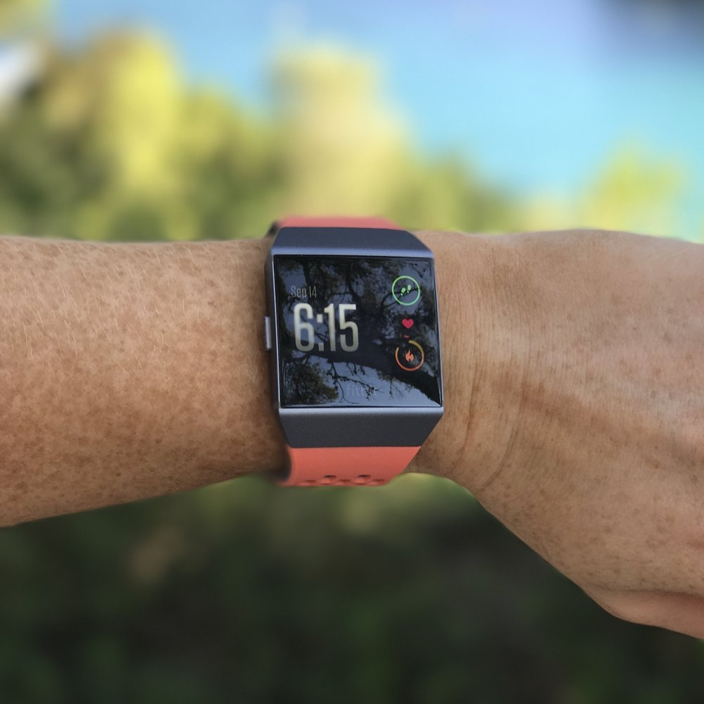 The FitBit Ionic with the peach sports band