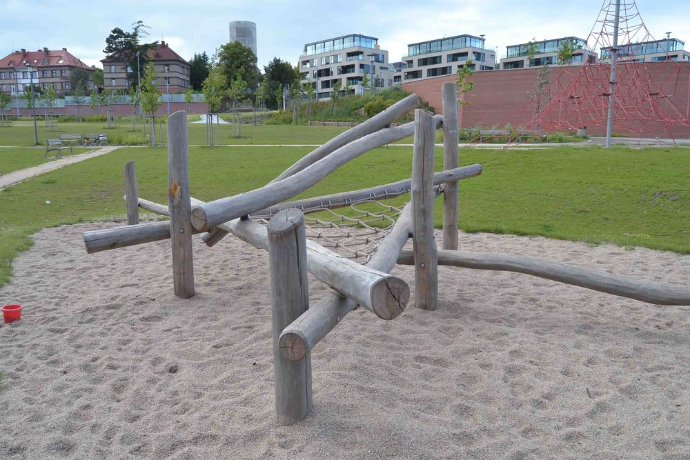 Play equipment has fine gravel surrounding - easy on children's feet. How does it not spread with no edging I wonder.