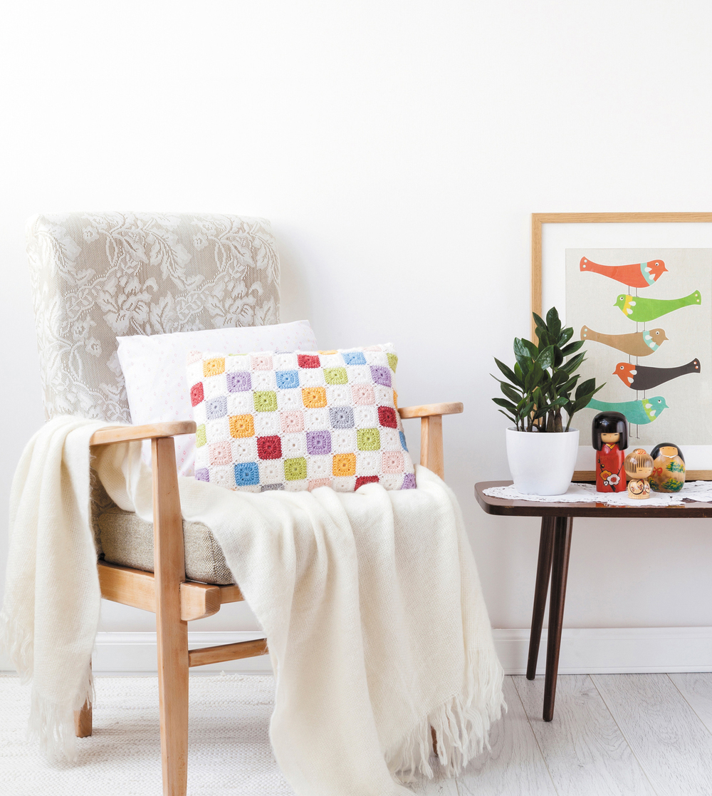 Tiny Squares Patchwork Cushion from Crochet Home by Emma Lamb | Crochet designs and styling by Emma Lamb / Photography by Jason M Jenkins