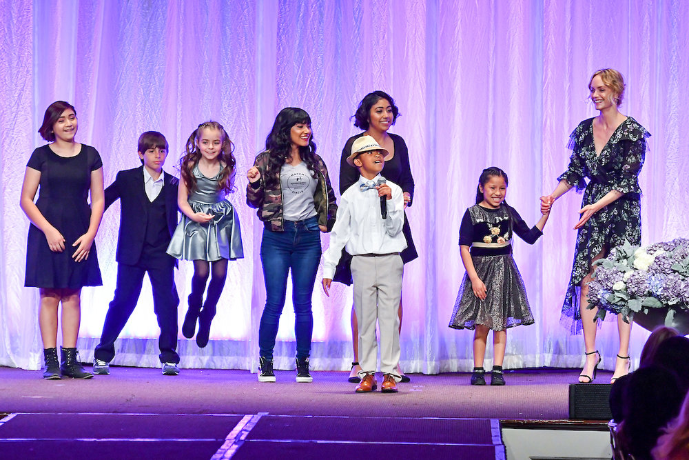 Littles and Amber Valletta on stage