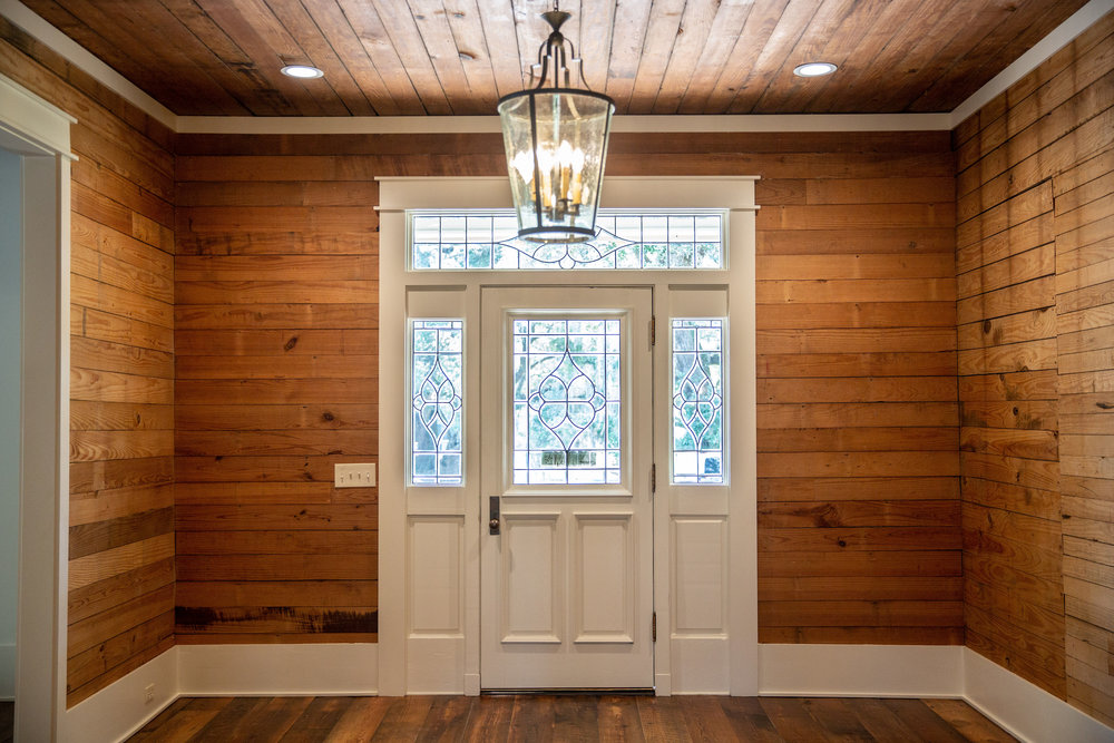 Even though the 1926 Creole dogtrot cottage needed a ground-up renovation, Melane made every effort to retain the characteristics she loved as a girl, such as its inviting entryway and cedar tongue-and-groove paneling.