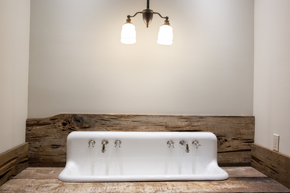 With the kind of rustic-meets-elegant-country style that befits both the home and its owner, this powder room reflects Melane's knack for making beautiful things belong together.