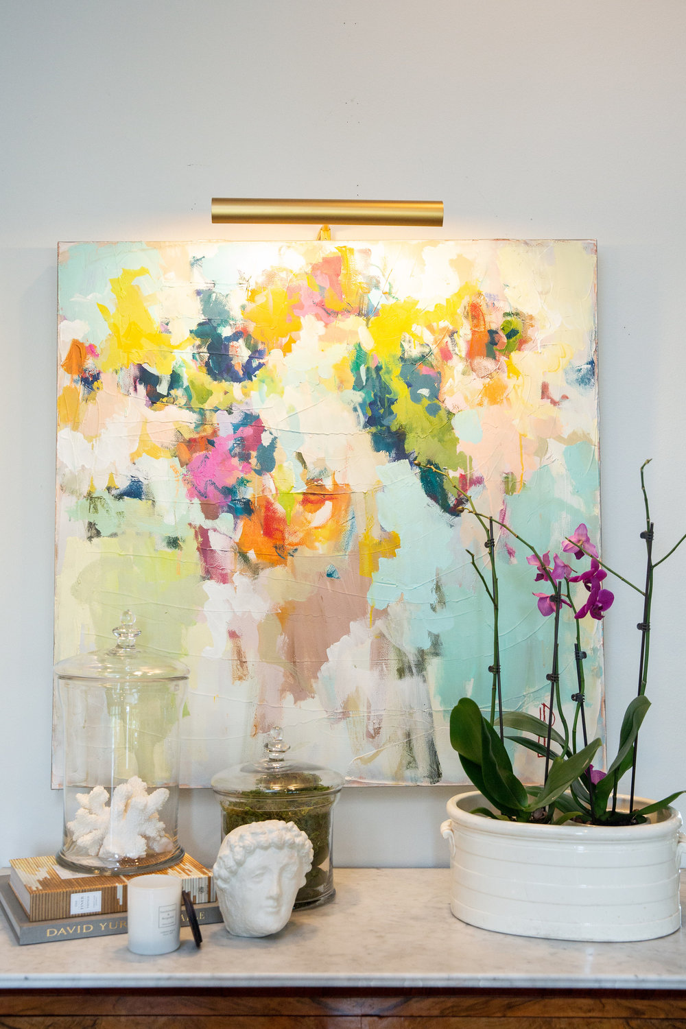 Lauri and Storm worked together on finding just the right piece to compliment an eclectic, color-loving style. This piece was commissioned from a local artist.