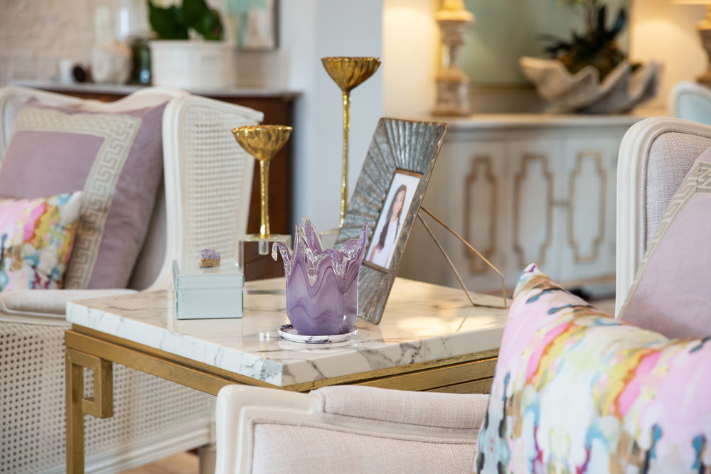 Custom pillows and decor pieced together from Signature's showroom create an effortless style when combined with family treasures.
