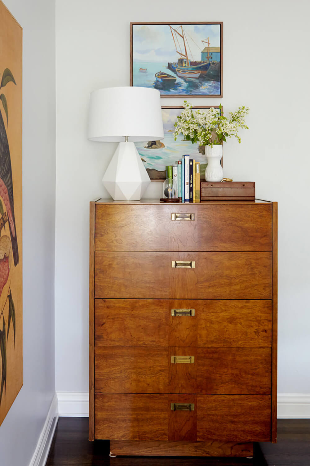 A Mid-Century nook by  Emily Henderson Design  incorporates another design trend for spring: realistic faux florals.