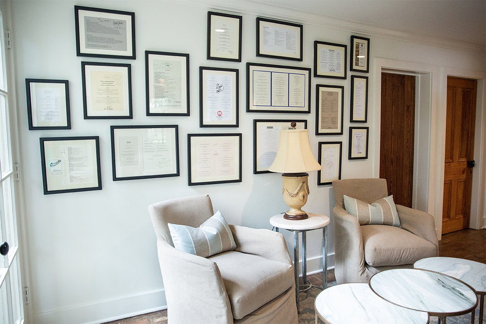 In this seating nook alongside the homeowner's kitchen, the design team used framed, autographed menus from favorite restaurants to add interest and individuality.