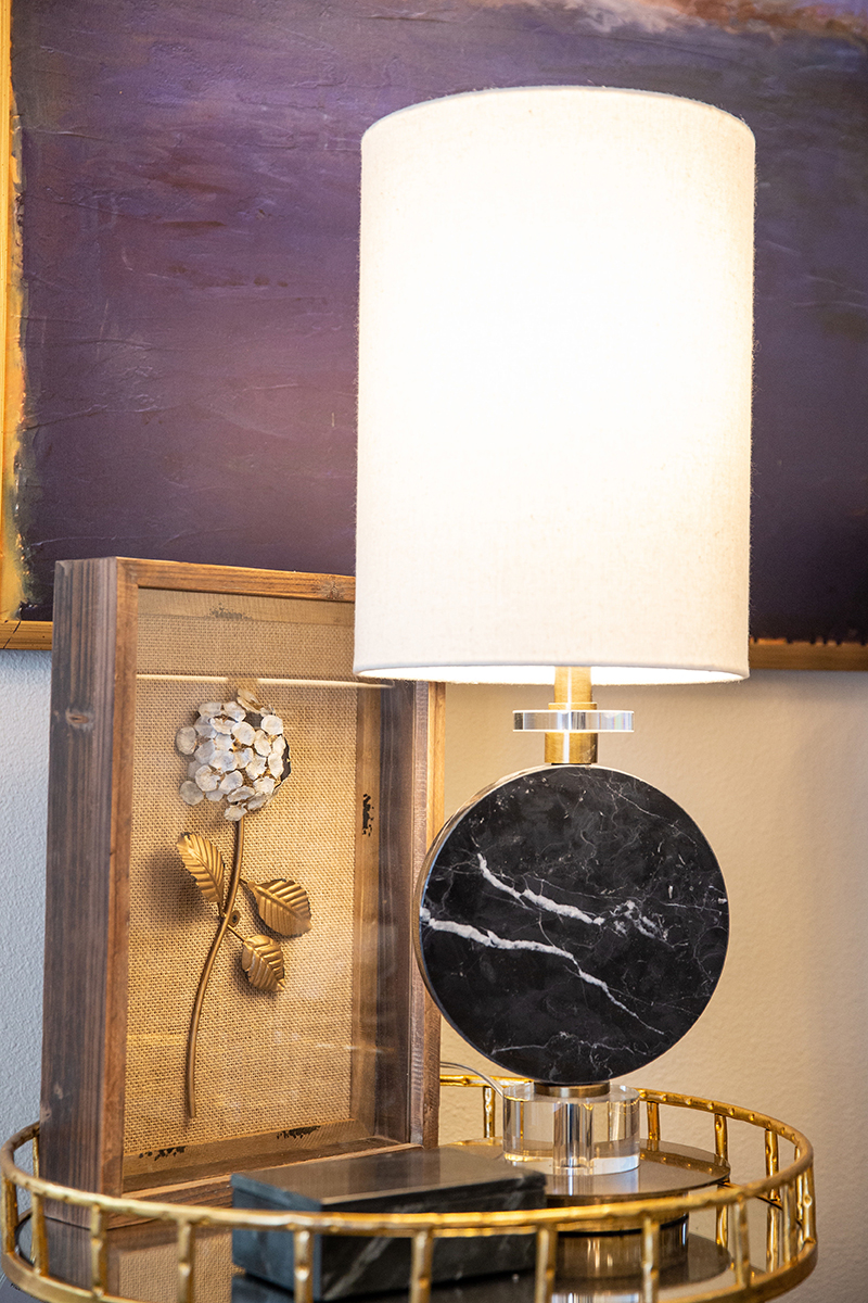 Investing in a few key pieces, like a lamp, artwork, or an interesting rug, can transform a room.