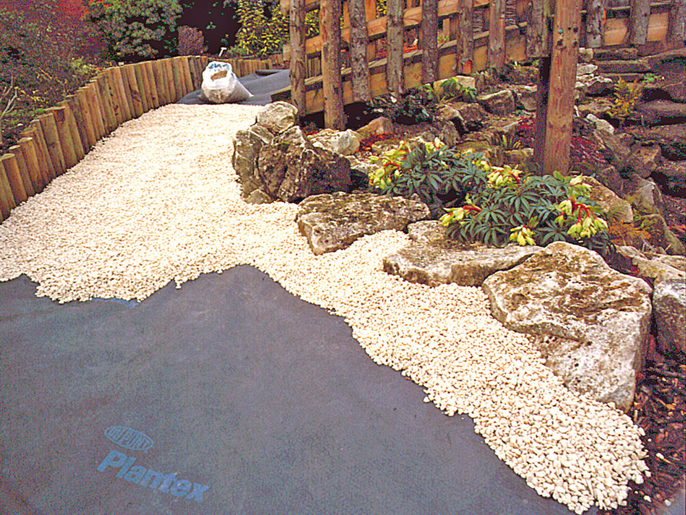 Plantex Weed Control Fabric  Shown here under a gravel pathway.