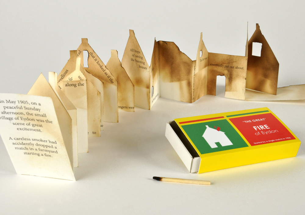 Match box book. Printed paper, folded and scorched. Approx. 4cm x 7cm x 1.5cm
