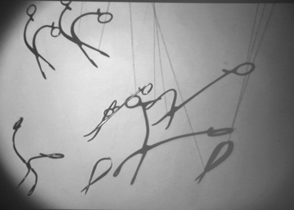A slow motion film of the shadows cast by surgical instruments