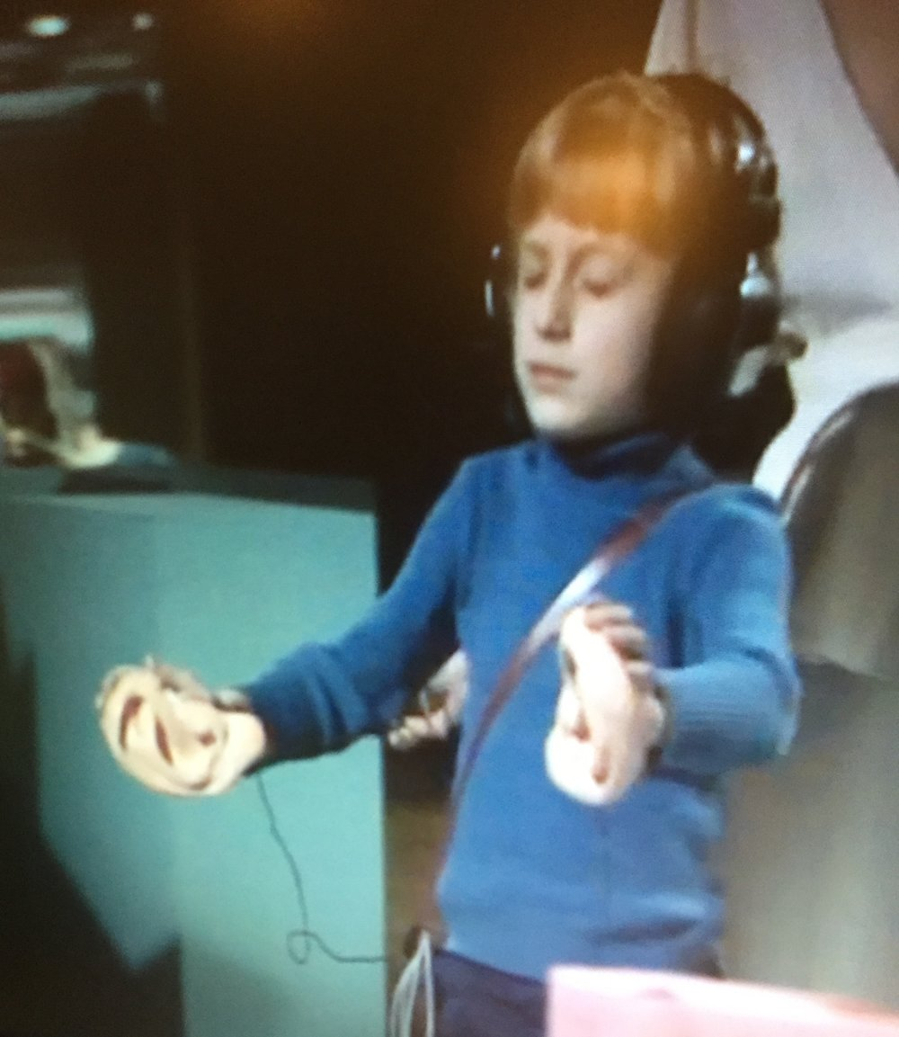 The author, aged seven, in an episode of TV's Tomorrow's World, tries to find a ticking box using ears attached to his hands. Yes, really.