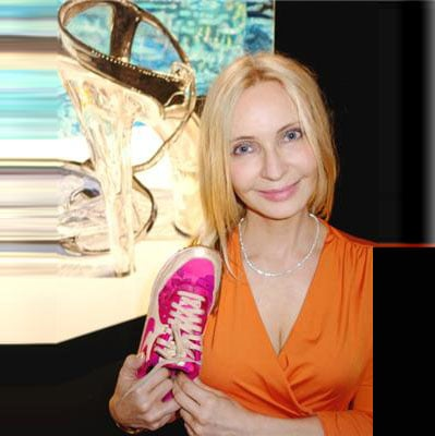 Ann Goldberg's sneakers contrasted with the Lucite pumps she painted for Art's Umbrella's act-your-shoe-size-themed art auction.