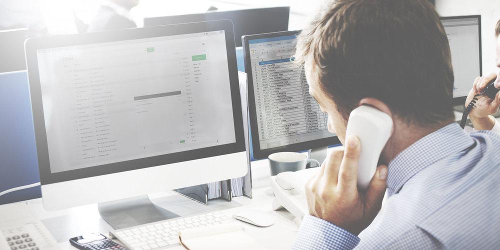 54780689-Businessman-Using-Telephone-Corresopndence-E-mail-Concept-Stock-Photo.jpg