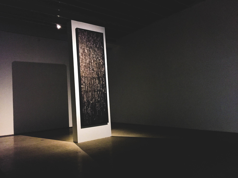 A monolithic ink painting seen in Cao Chang Di's 'Red Bricks' Gallery Space