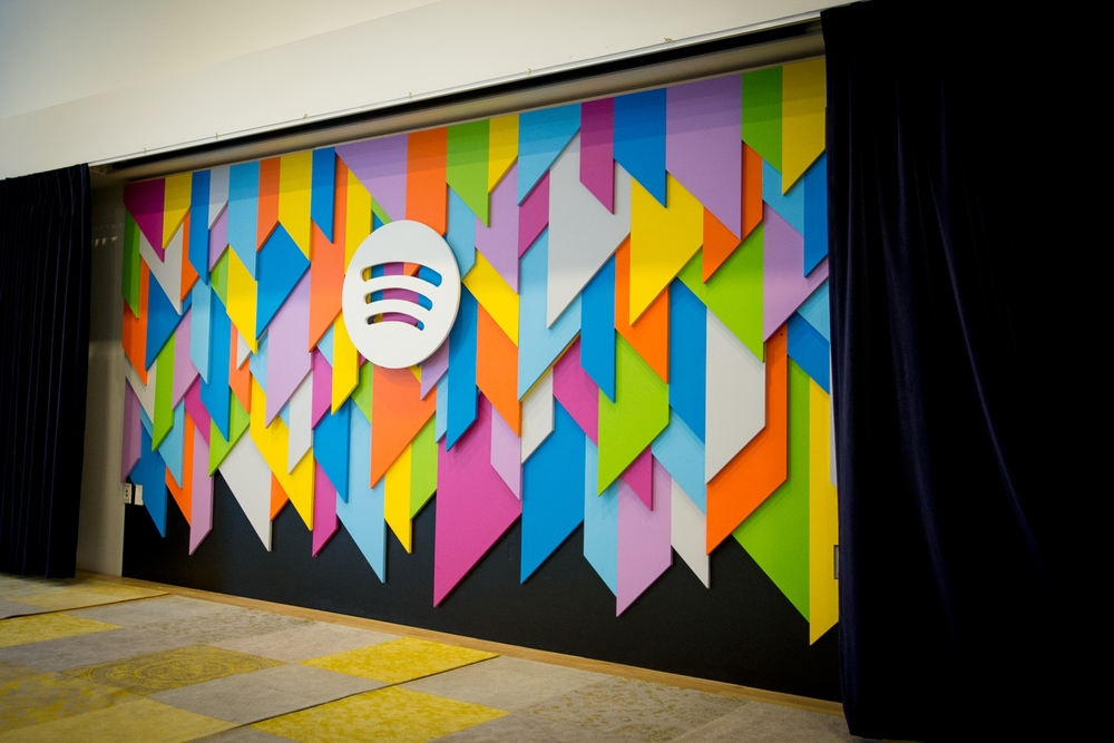 A New Background on a Stage at the Spotify NYC Office for Live Performances Client: Spotify. Concept and Photos by: Sarah Gainer. Design, Engineering, and Fabrication by: Grain Control.
