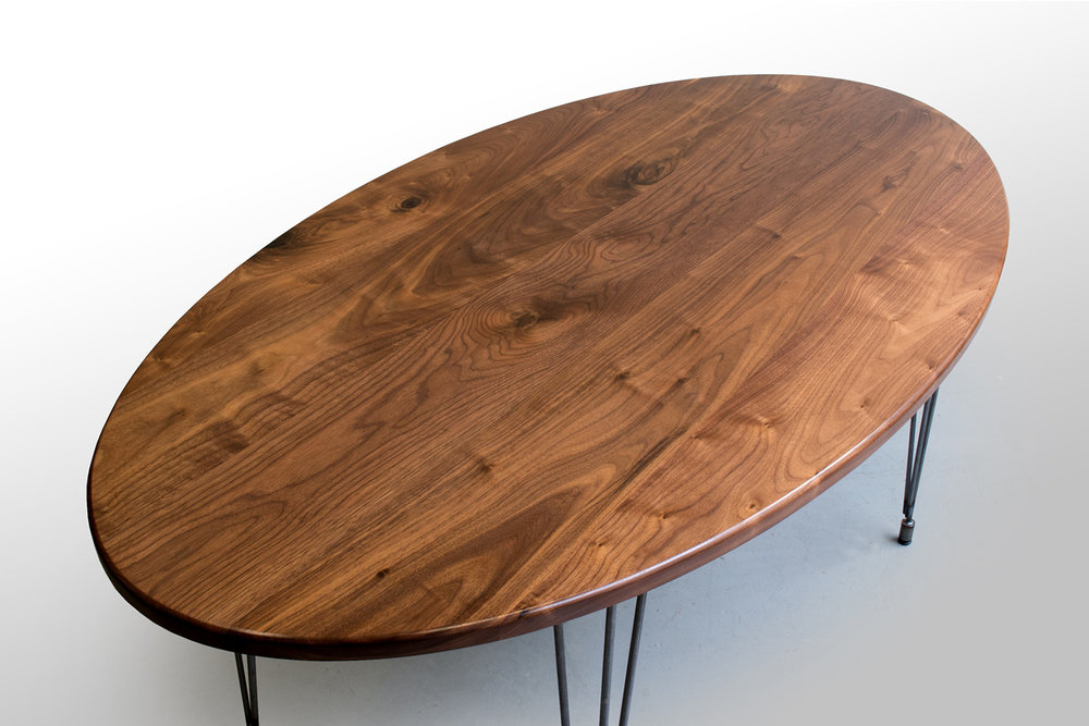 Left closeup Walnut oval kitchen table.jpg