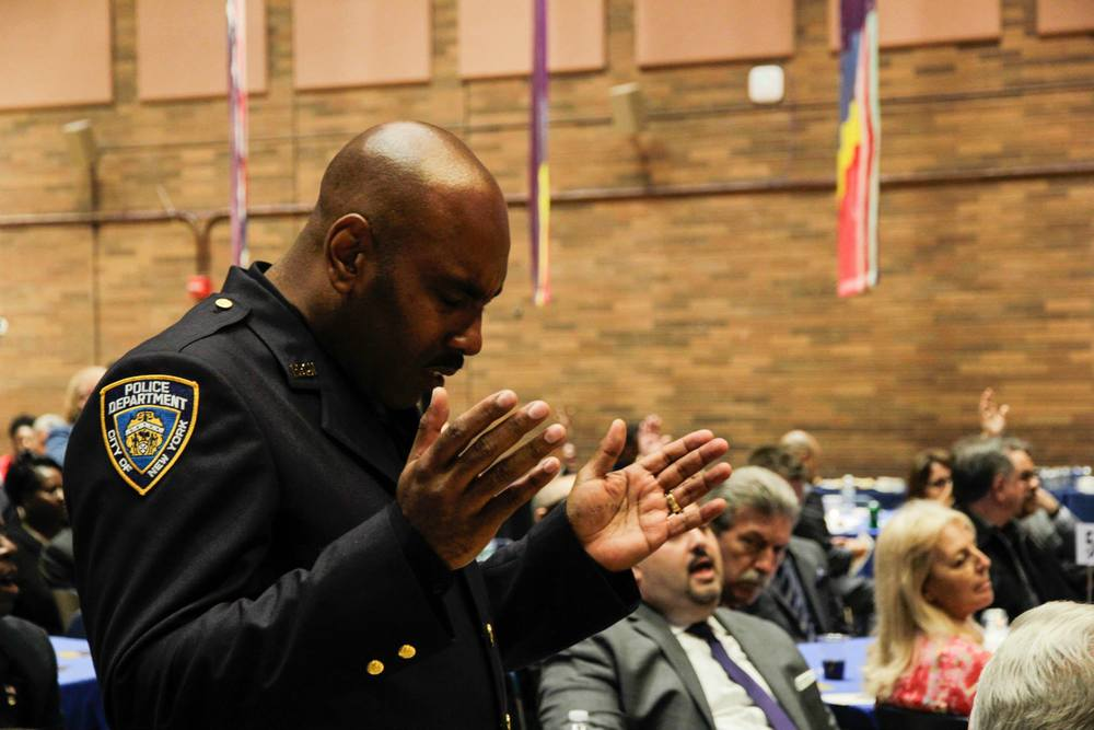 Individuals worshipping during the gathering for NYPD.