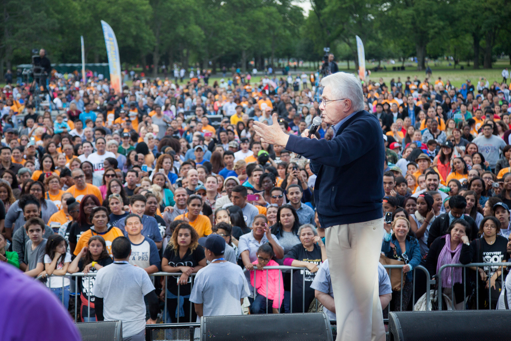 Luis Palau greets the crowd as they arrive for NY CityFest in Queens.