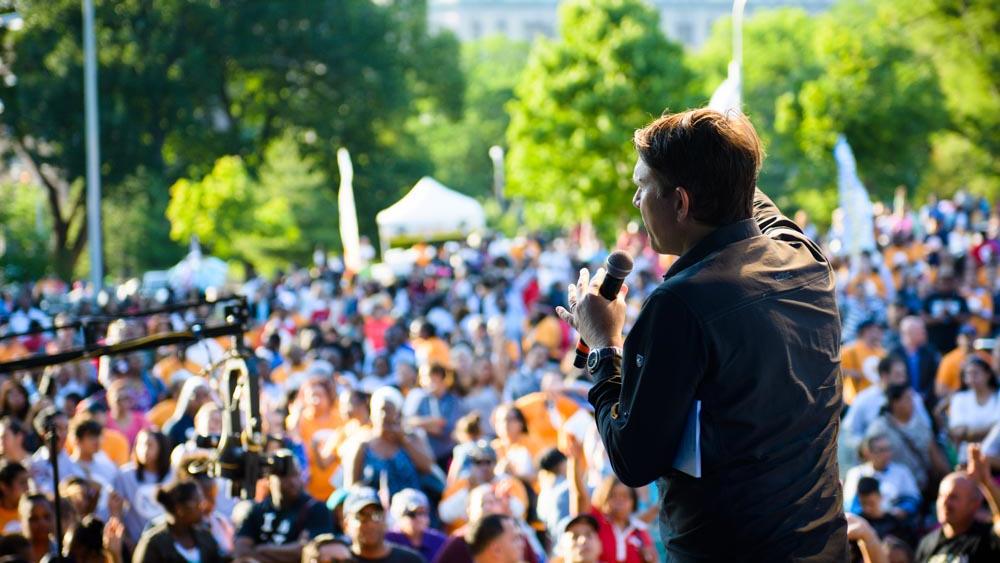 Andrew Palau preaching preaching in Flushing Meadows, Queens.