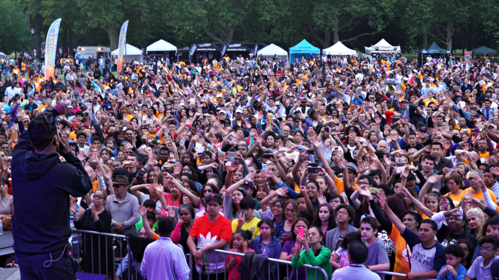 The crowd gets into the music at Flushing Meadows, Queens.