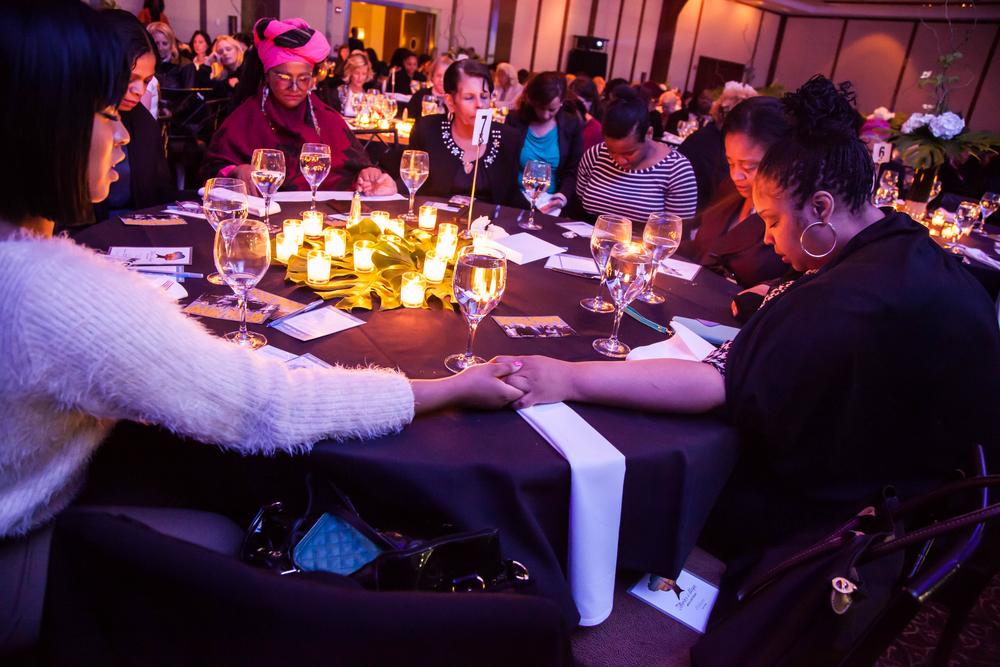 Women praying at a special gathering in Manhattan.