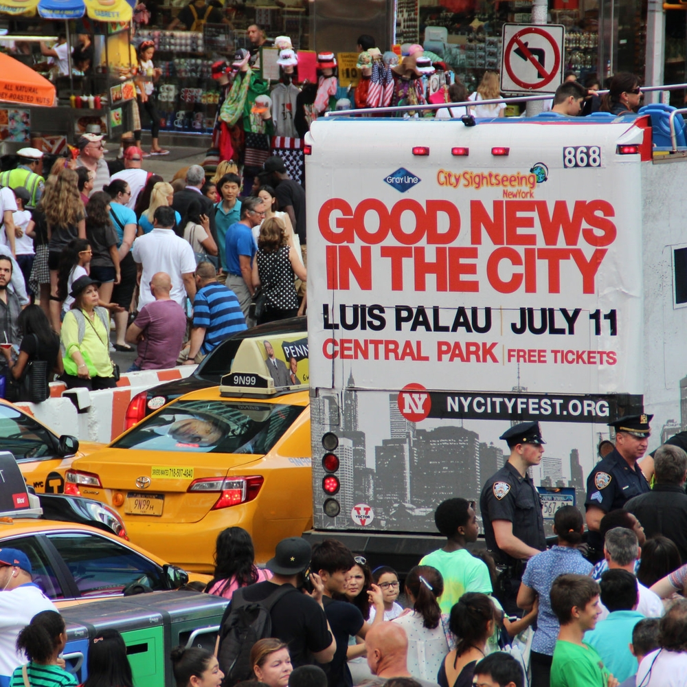 A NY CityFest double-decker bus makes it's way through Times Square.