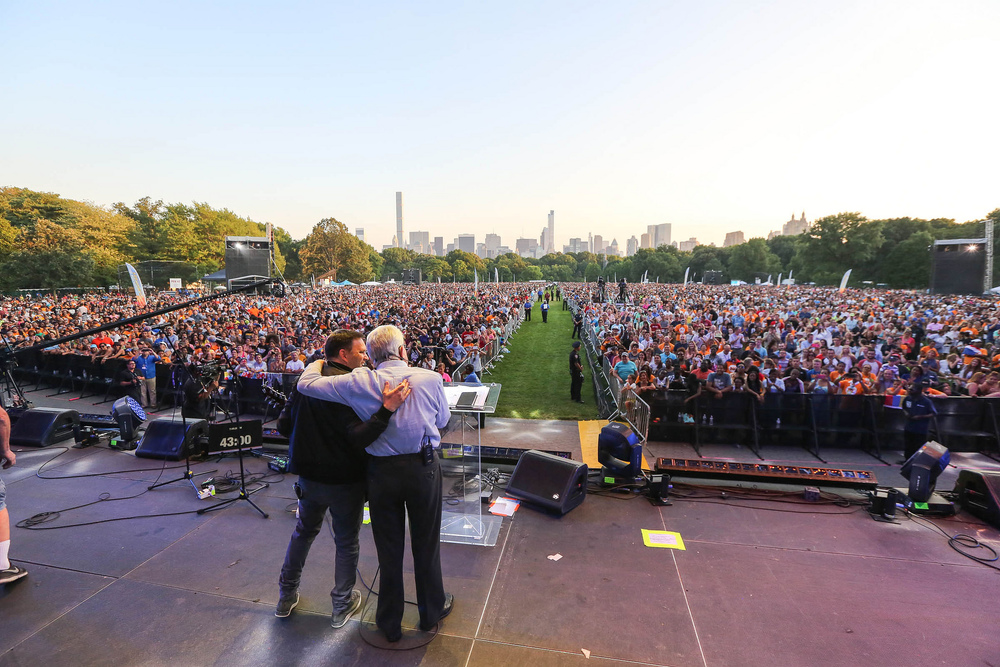Luis Palau and Matt Redman greet the crowd in Central Park.