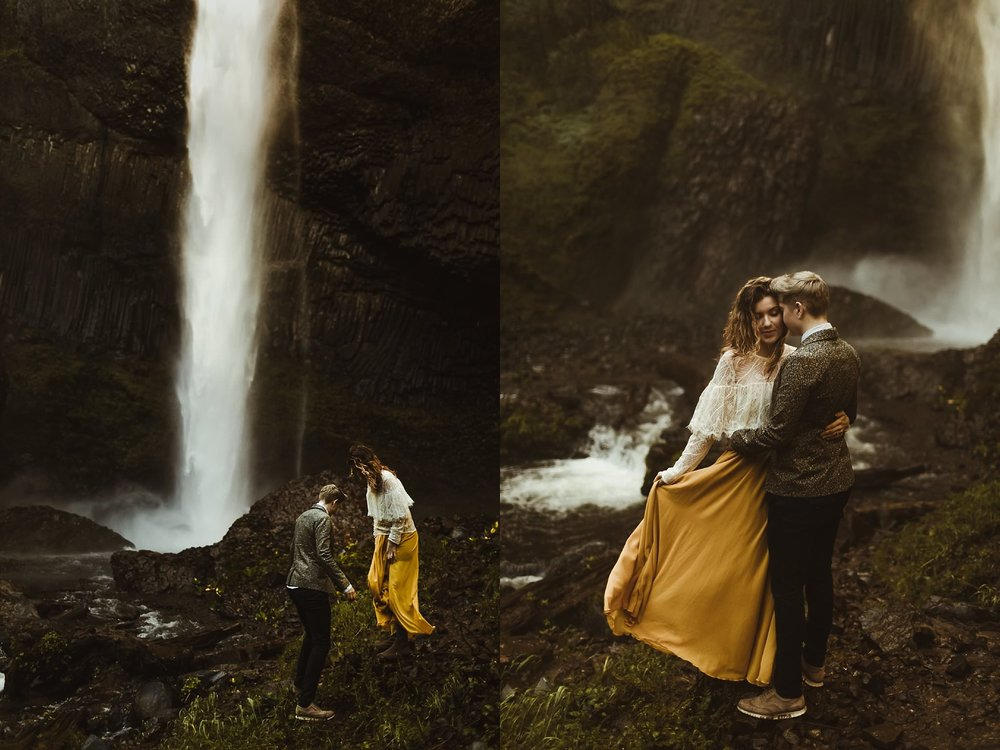 An adventurous couple getting splashed underneath the Latourell Falls during their elopement