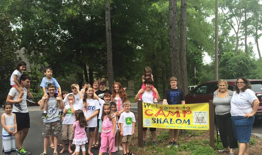 camp shalom with sign.jpg