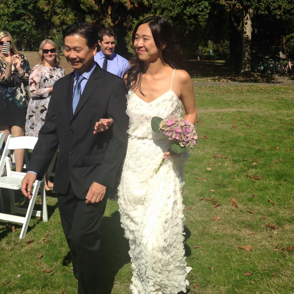 Yvette walks down the aisle with proud papa Reggie.