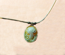 Emmy's Medleys - Antique cameo brought to life with costume pearls, a sterling silver backing and leather necklace.