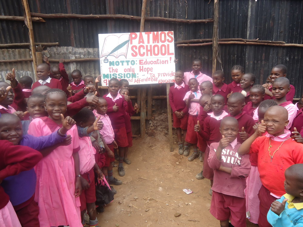 5. children with school sign Feb 2017.JPG