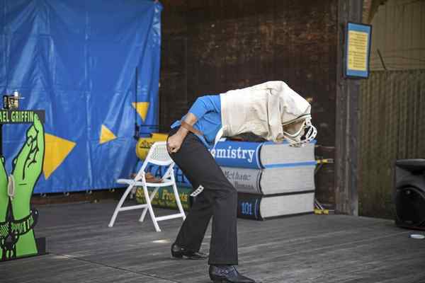 Michael Griffin escapes from a straightjacket at the during his Friday performance. Sam Armanino — The Times-Standard