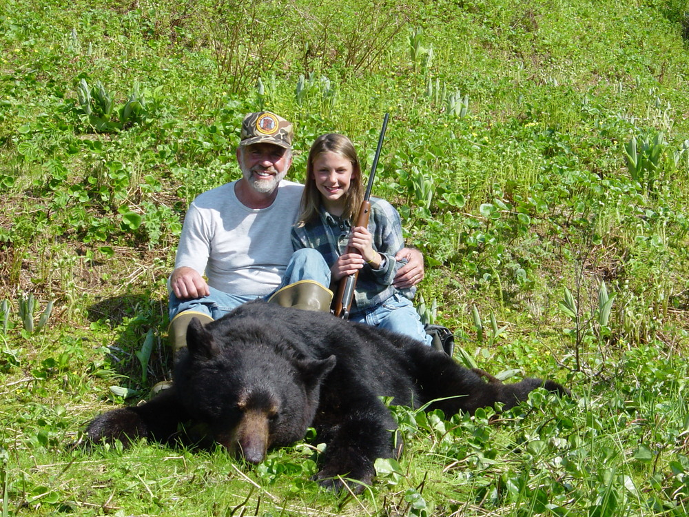 "Granddaughter Jordan and me with her 6'8"" black bear."