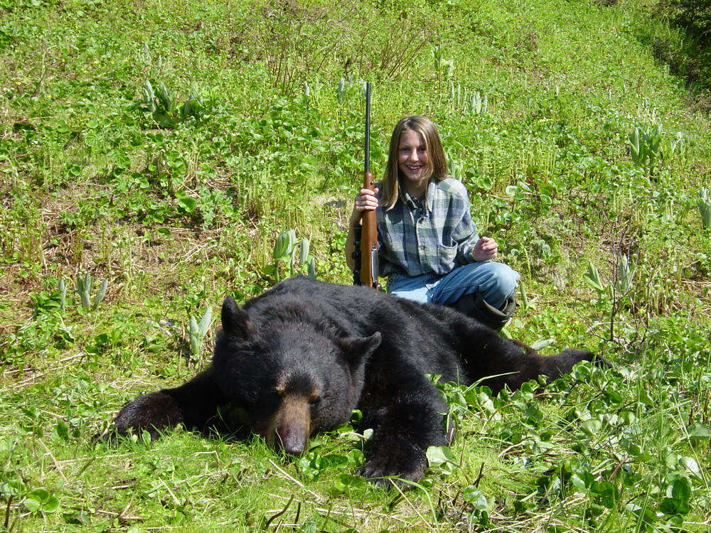"My granddaughter Jordan Juliussen Johnson at age 11 with her Prince William Sound black bear.  It squared 6'8""."