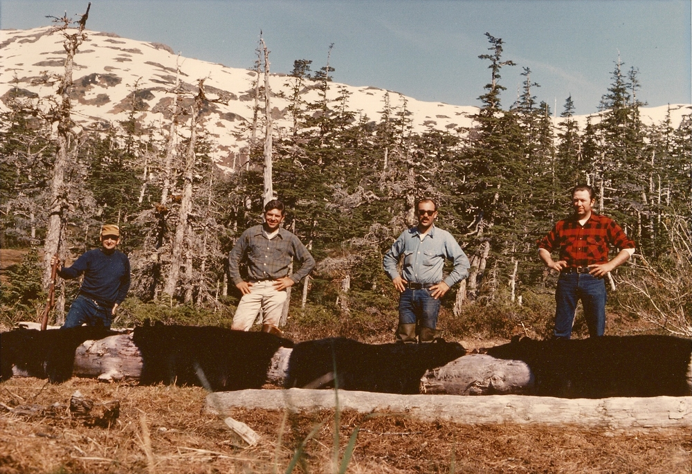 The first time we harvested 4 bears and used the big log for pictures.  From (L to R) Eddie Lanoue, myself, Earl Boucher and Hanceford Clayton.  All Air Force buddies back in the 70's.
