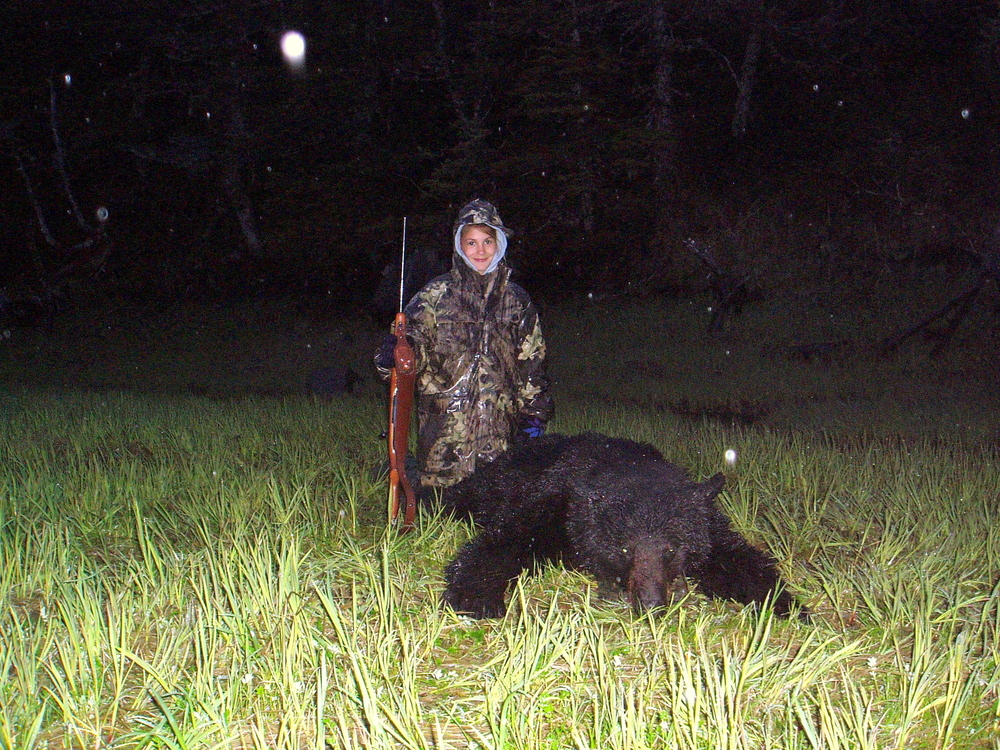 "My 11 year old granddaughter Rachel Juliussen with her 6'7 ""black bear.  Her hunt actually lasted only 2 hours.  She is a great shot and a very lucky hunter."