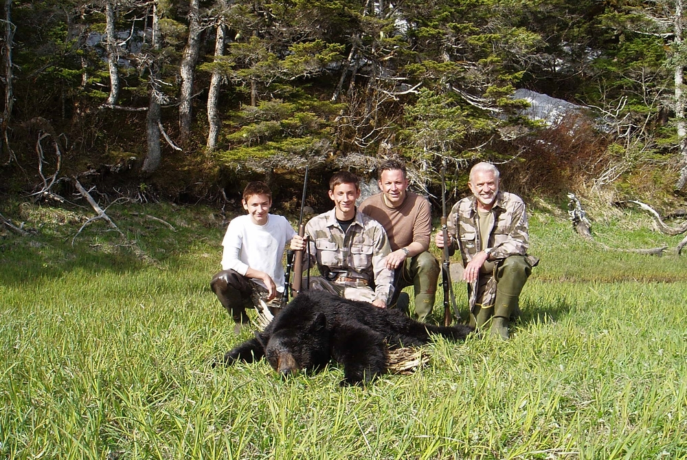 "Jared with his 6'5"" black bear.  From (L to R) Nathan, Jared, son-in-law Sagen and myself.  According to the Alaska Department of Fish & Game this bear was 32 years old.  I did some research and only found one bear that was older.  It was a 33 year old tagged bear taken in Wisconsin."