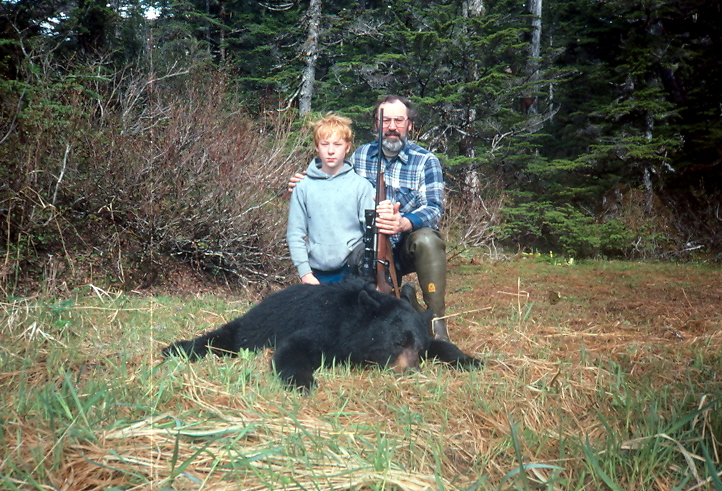 Earl Boucher with his 10 year old son Brian and Brian's 6'+ black bear.