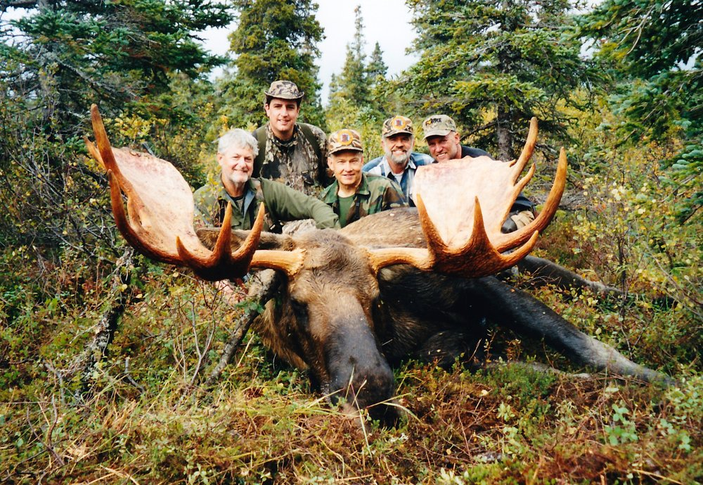 "(L to R) Clients Tom Wells and his son Tom Jr., guide Ron Watts, myself and guide/packer Tom Losk with Tom's 58"" moose."