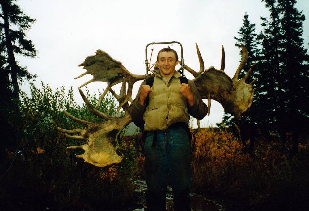 Scott Herbert with the locked moose antlers that he packed back to camp.