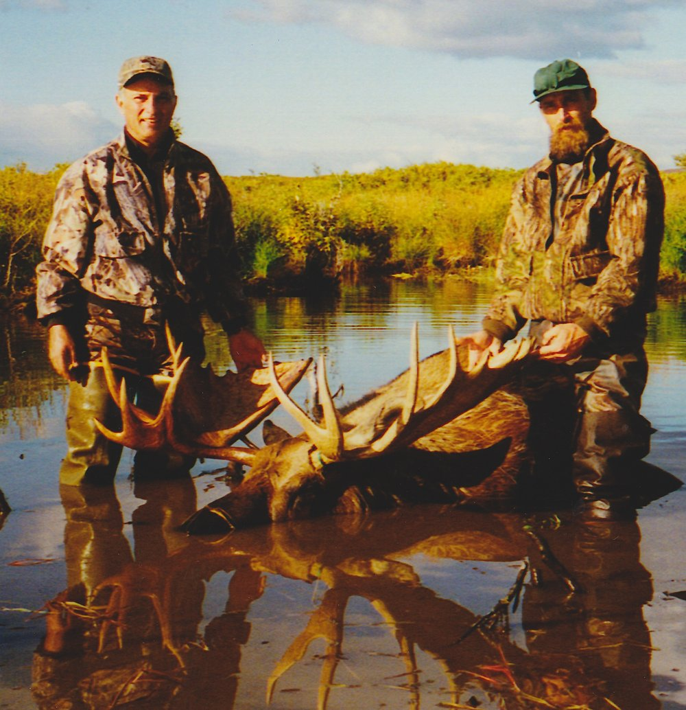 (L to R) Ralph Papenheim, MN, and guide Truman Grinter with Ralph's moose after Eric broke the dams and the water had started to drain out of the beaver pond.